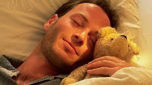 adult with teddy bear